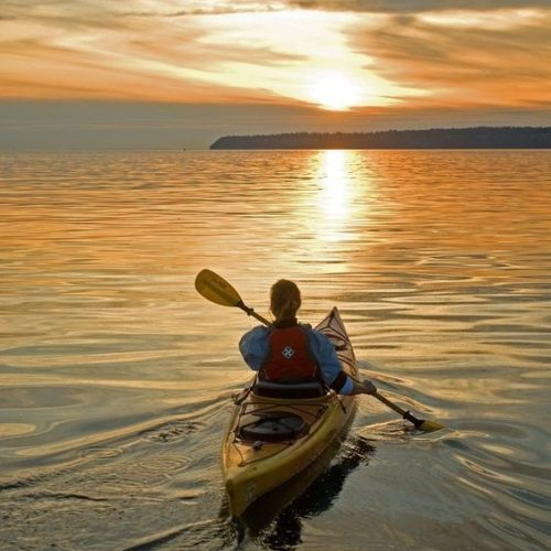 kayaker on the water in sunset