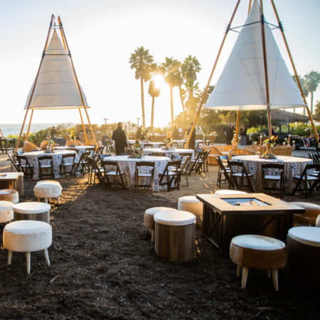 Beachfront Event at Ritz Carlton Bacara with a coastal, tribal theme. Includes feathers, shells, firepits, rocks and teepees.