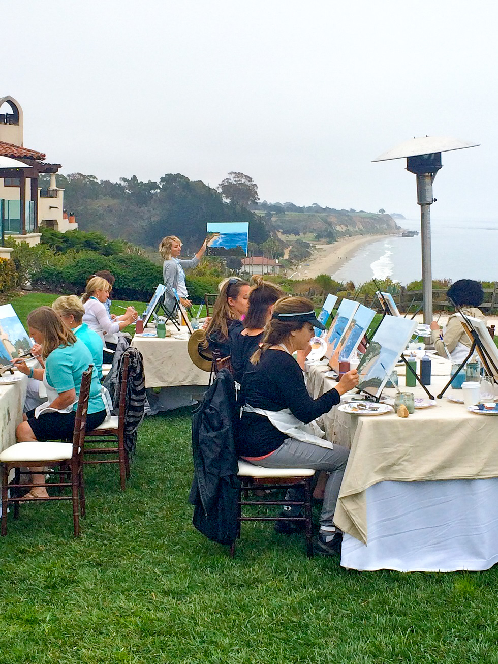 A group Painting an oceanfront bluff view