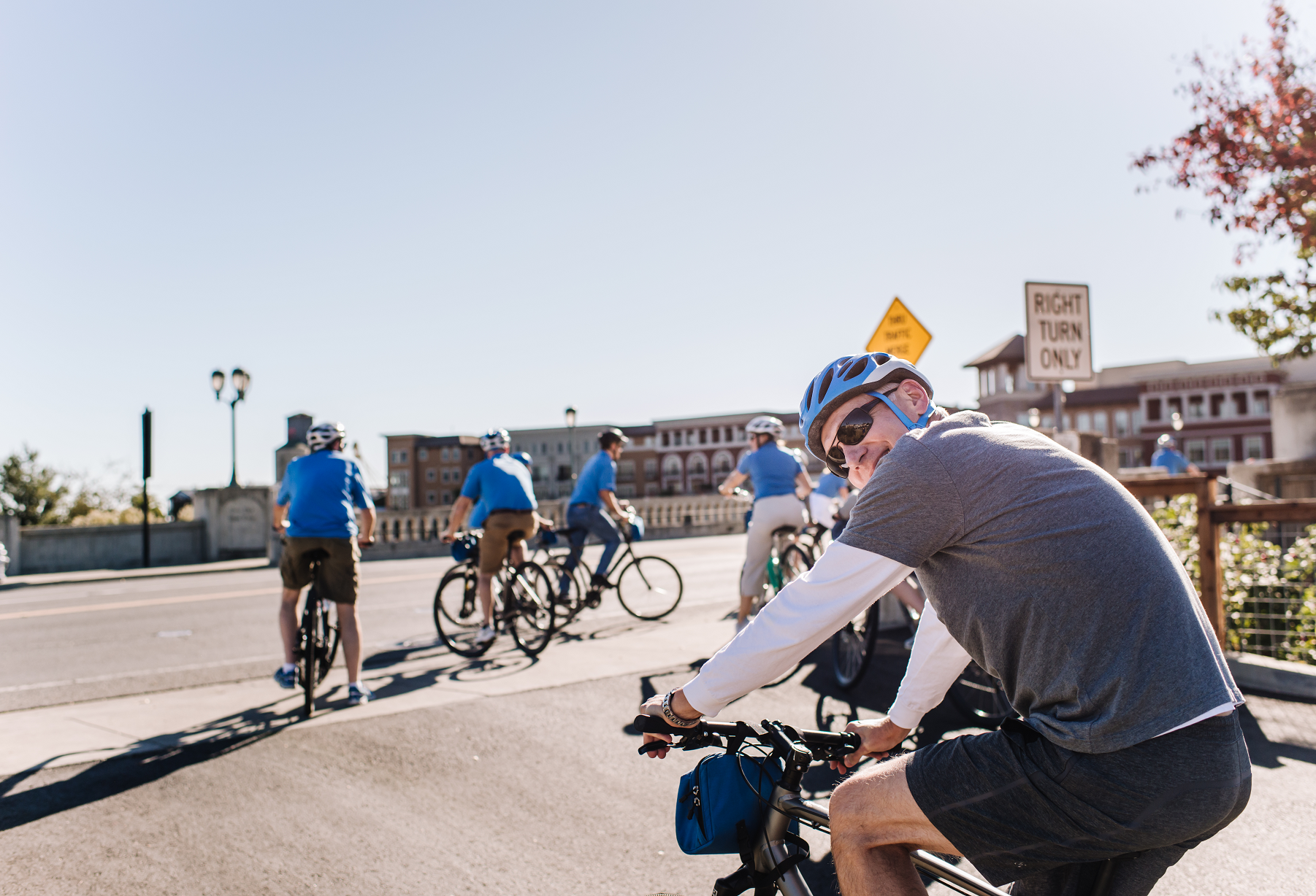 A group of bikers touring through downtown Napa