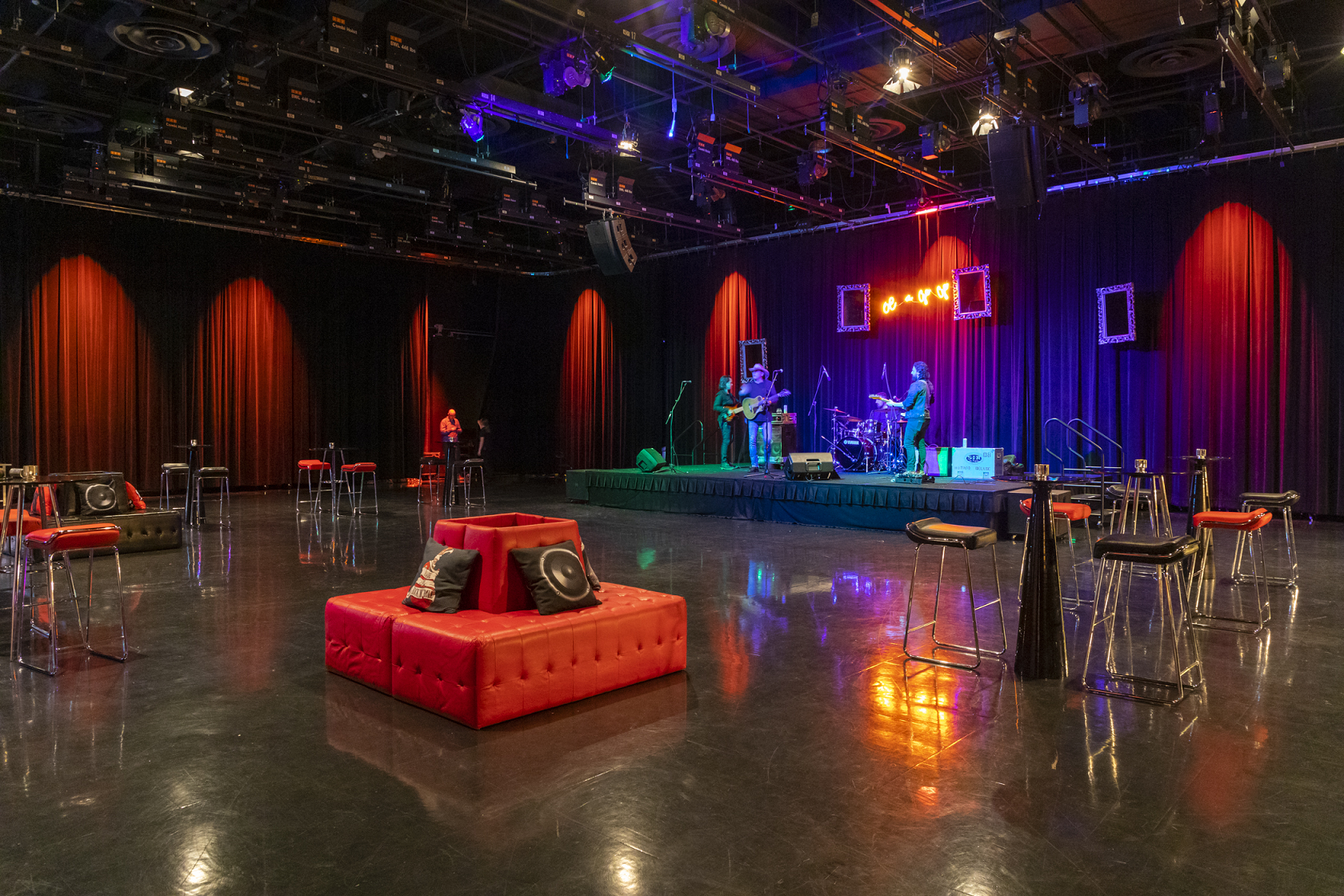 A Studio space is set up with red and black furniture  and accent decor to emulate the famous Whiskey-a-Go-Go Bar