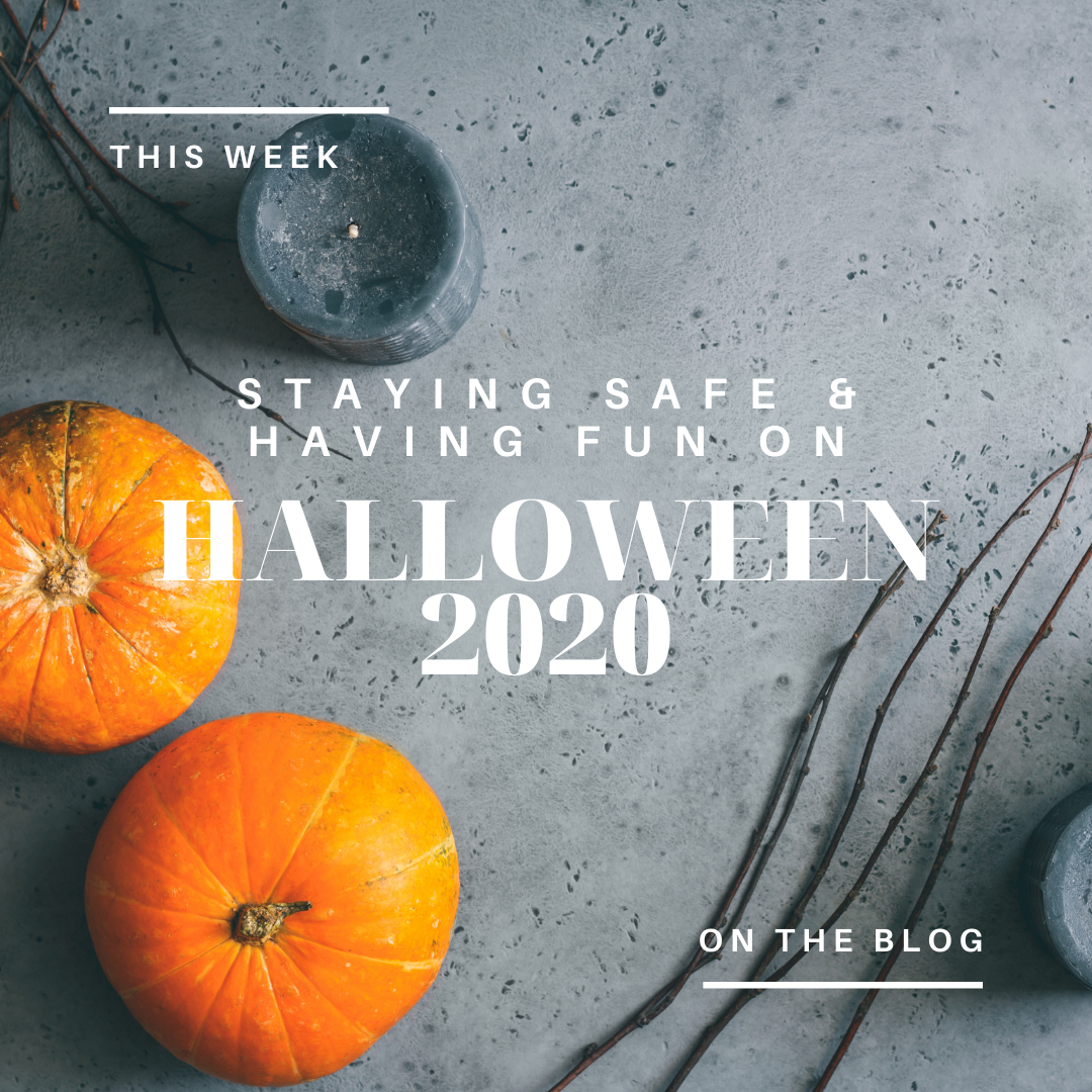 gray background with pumpkins and candles